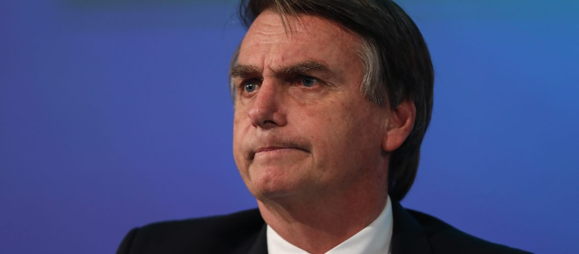 Jair Bolsonaro, presidential candidate for the Social Liberal Party (PSL), listens during a National Confederation of Municipalities (CNM) event at the International Convention Center of Brazil (CICB) in Brasilia, Brazil, on Wednesday, May 23, 2018. Brazil's presidential election race is quickly thinning and will ironically leave only seasoned politicians able to win a race marked by deep-seated, anti-establishment sentiment. Photographer: Sergio Lima/Bloomberg