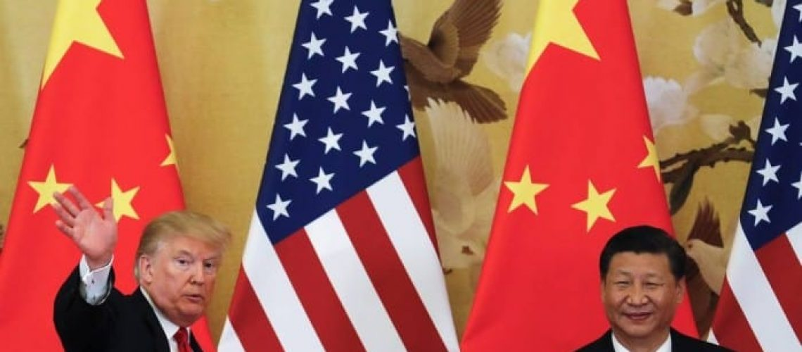 73722316_FILEIn-this-Thursday-Nov-9-2017-file-photo-US-President-Donald-Trump-waves-next-to-Chine