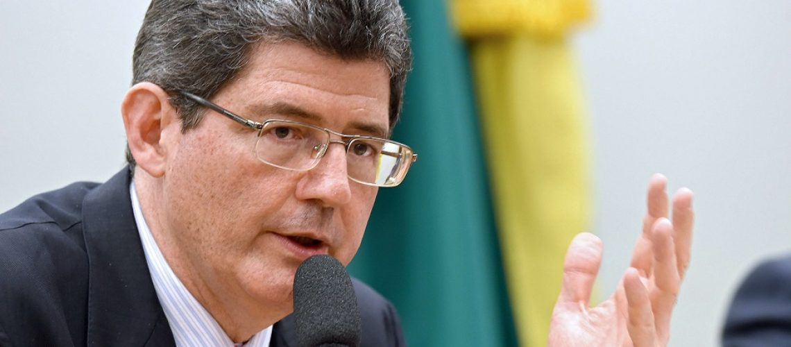 Brazilian Minister of Finance Joaquim Levy speaks during a public hearing at the National Congress in Brasilia on November 24, 2015. Levy keeps negotiating with pro-government and opposition parliamentarians for the approval of the fiscal adjustment proposed by the government. AFP PHOTO/EVARISTO SA