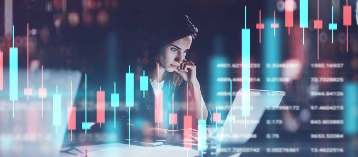 Young,Woman,Working,At,Night,Modern,Office.technical,Price,Graph,And