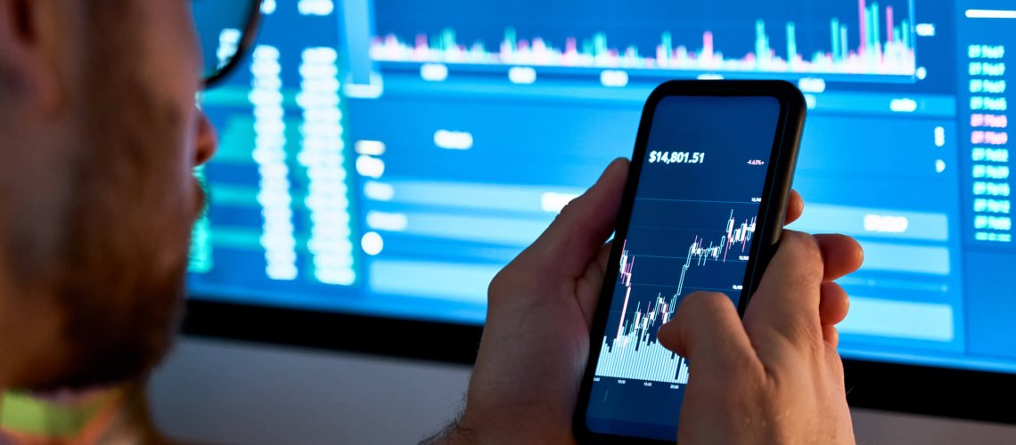 Business,Man,Trader,Investor,Analyst,Using,Mobile,Phone,App,Analytics